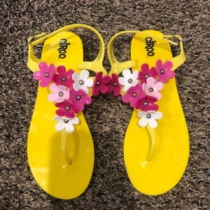 Yellow sandals with adorable flowers